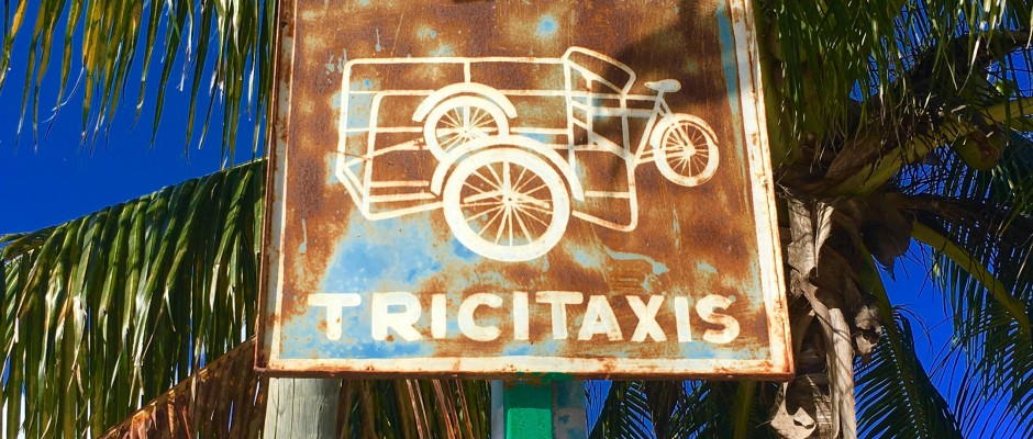 Tricycle taxis sign.