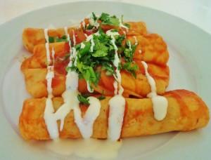 Mexican cooking entomatadas media crema