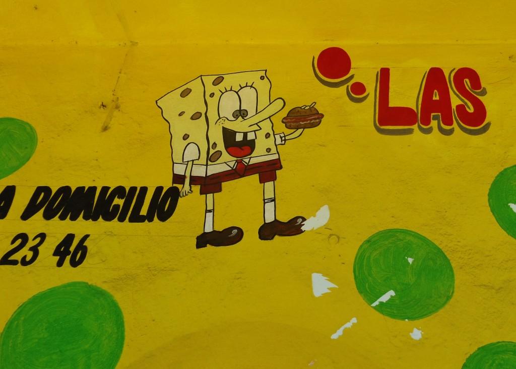 Cartoon advertisements in Playa Del Carmen