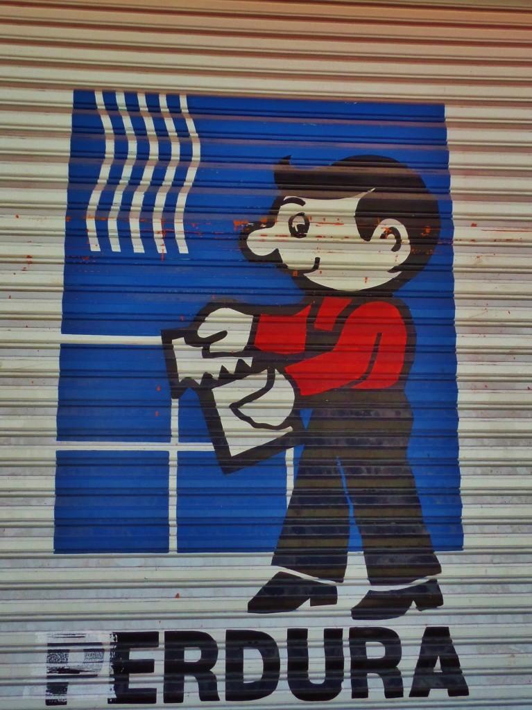 Cartoon advertisement in Playa Del Carmen