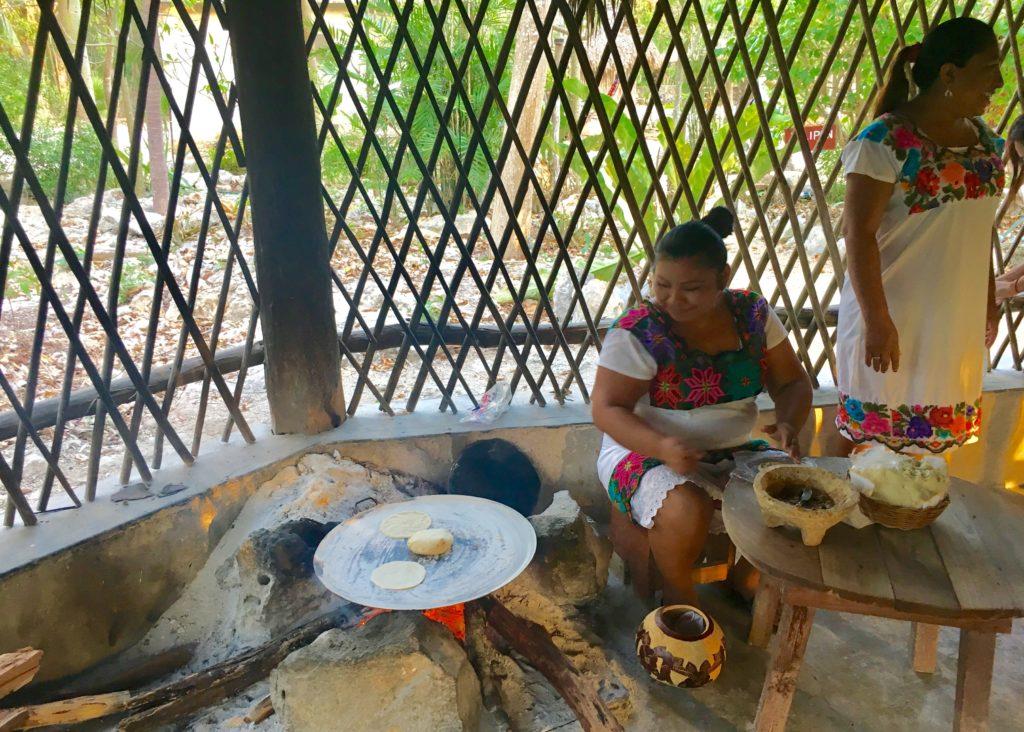 Mayans making tortillas